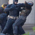 Close up photos of Batman vs Bane from The Dark Knight Rises