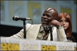 """SAN DIEGO, CA - JULY 20:  Actor Djimon Hounsou (L) and actress Karen Gillan speak at Marvel's """"Guardians Of The Galaxy"""" panel during Comic-Con International 2013 at San Diego Convention Center on July 20, 2013 in San Diego, California.  (Photo by Alberto E. Rodriguez/WireImage)"""